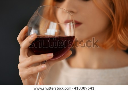 Young woman with glass of red wine closeup - stock photo