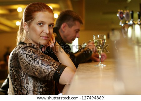 Young woman with glasse of wine at restaurant - stock photo