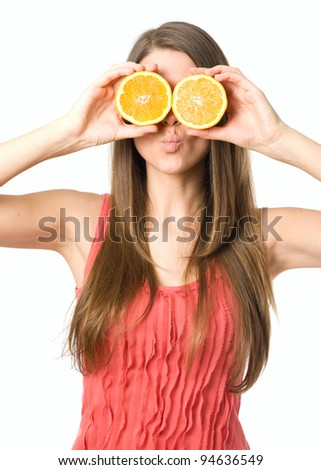 Young woman with glasses made with orange fruits - stock photo