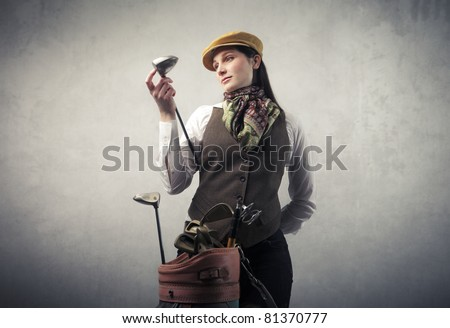 Young woman with golf equipment - stock photo