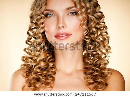 Young woman with gorgeous beautiful curly hair. Blond Hair. - stock photo