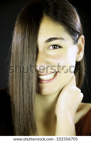 Young woman with gorgeous smile and amazing long straight hair