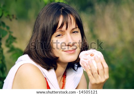 Young woman with grapefruit at the summer park