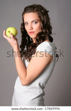 young woman with green apple - stock photo