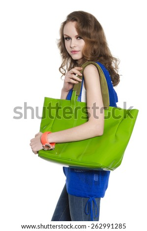 young woman with green bag posing - stock photo