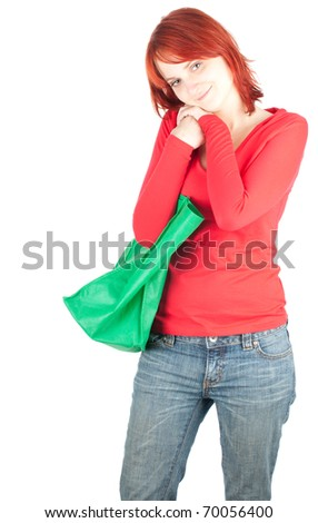 young woman with green ecological shopping bag