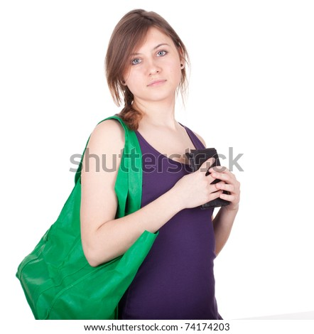 young woman with green ecological shopping bag - stock photo