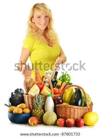Young woman with groceries including vegetables, fruits, dairy and bakery products and wine isolated on white