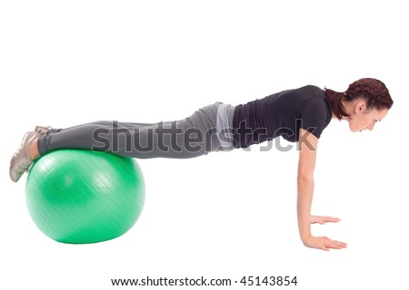 Young woman with gym ball doing pushup exercise, isolated on white background.