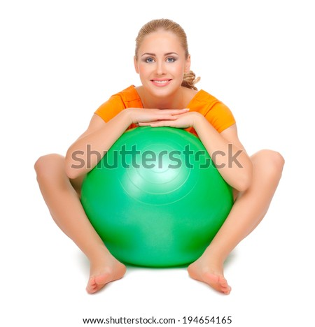 Young woman with gymnastic ball isolated - stock photo