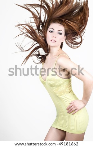 Young woman with hair flying in blurred motion