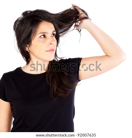 Young woman with hair problems isolated on white - stock photo
