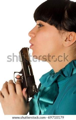 Young woman with hand gun isolated on white