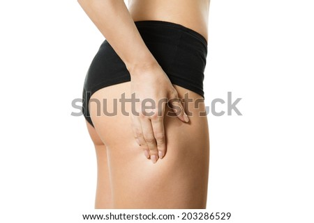 Young woman with hand on her haunch. Part of body. Close-up. Isolated over white background. - stock photo