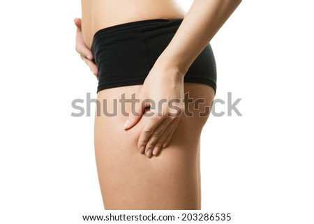 Young woman with hand on her hip. Part of body. Close-up. Isolated over white background. - stock photo