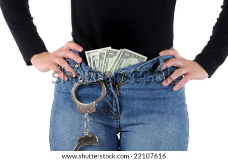 Young woman with handcuffs and Euro-Money