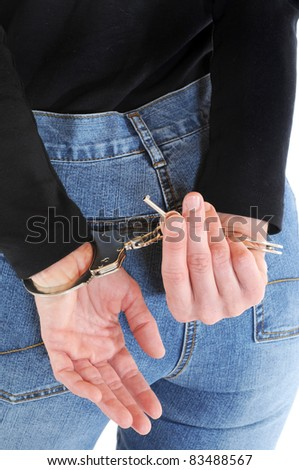 Young woman with handcuffs and key - stock photo