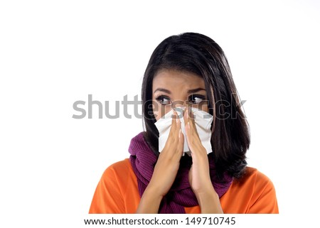 Young woman with handkerchief having cold. Isolated over white background - stock photo