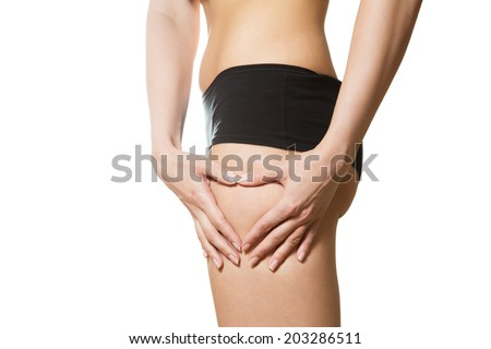 Young woman with hands in heart shape on her hip. Part of body. Close-up. Isolated over white background. - stock photo