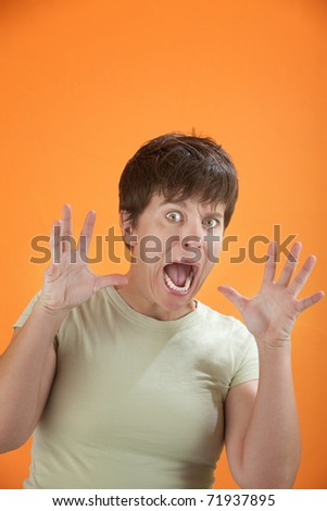 Young woman with hands near face looking horrified
