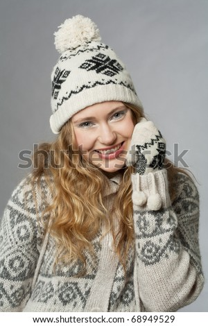 young woman with hat and gloves - stock photo