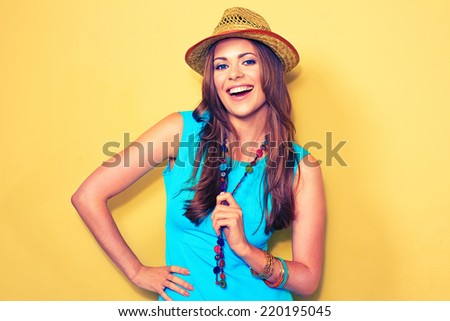 young woman with hat studio portrait. model with long hair . - stock photo