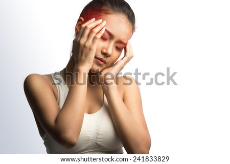 Young woman with headache holding her hand to the head ,on white background with clipping path
