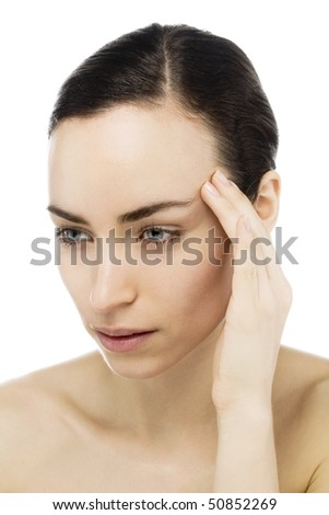 young woman with headache touching forehead - stock photo
