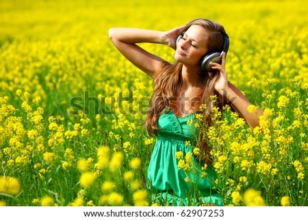 Young woman with headphones - stock photo