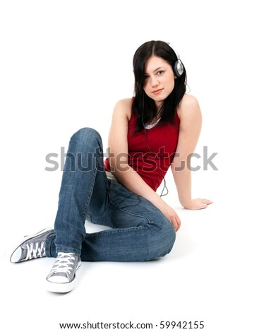 young woman with headphones and mp3 player - stock photo