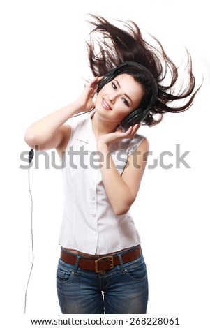 Young woman with headphones listening music  - stock photo