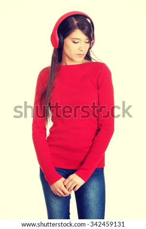 Young woman with headphones listening music. - stock photo