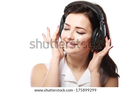 Young woman with headphones listening music close up face - stock photo