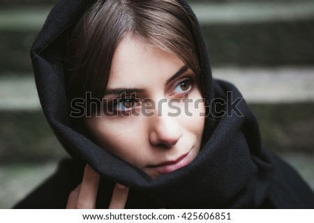 Young woman with headscarf, veiled,  looking side. - stock photo