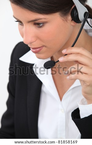Young woman with headset - stock photo