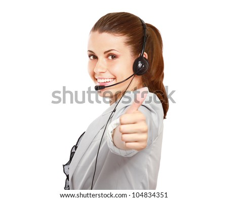Young woman with headset showing thumb up isolated on white background - stock photo