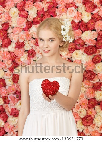 young woman with heart and background full of roses