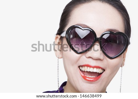 Young Woman with Heart Shape Glasses - stock photo