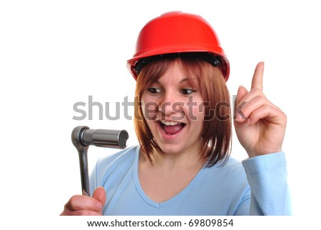 young woman with helmet holds a socket wrench