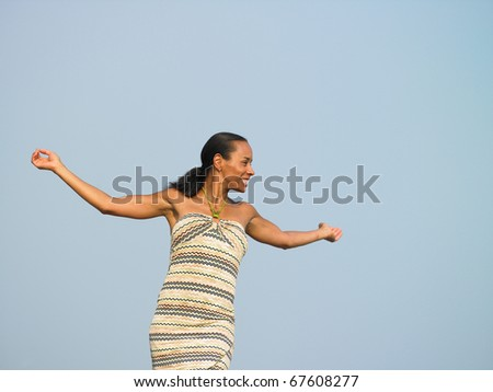 Young woman with her arms outstretched - stock photo