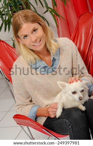 Young Woman with her dog at home - stock photo