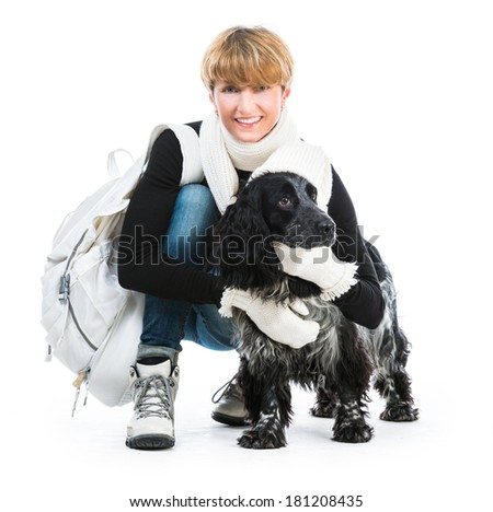 young  woman with her dog cocker spaniel in a studio isolated on a white background