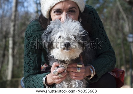 Young woman with her dog in the street - stock photo