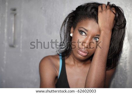 Young woman with her hand on her head - stock photo