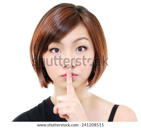 Young woman with her hand over her mouth - stock photo