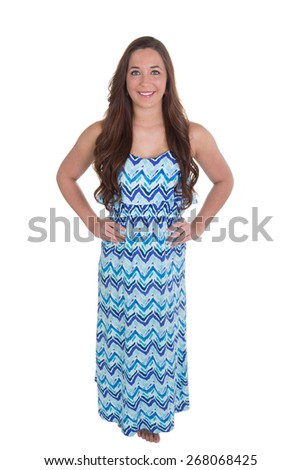 Young woman with her hands on her hips. Full length photo, isolated. - stock photo