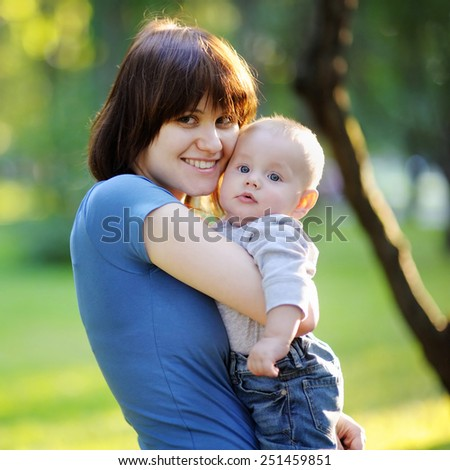 Young woman with her little baby boy
