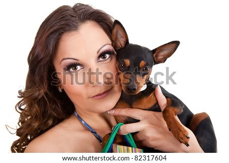 young woman with her miniature pincher puppy, close up, isolated on white - stock photo