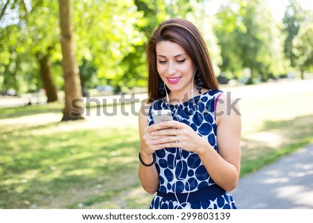 young woman with her phone and earphones