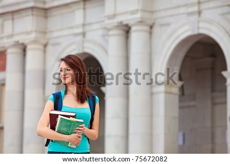 Young woman with her school books - stock photo